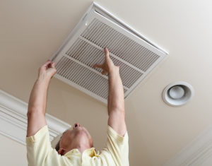 Man changing an air filter